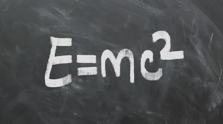 relativity : Albert Einsteins Most Famous Equation E = MC2 On Chalkboard. Great For Your Science  Physics  Math Related Projects. High-Quality Animation. Stock Footage