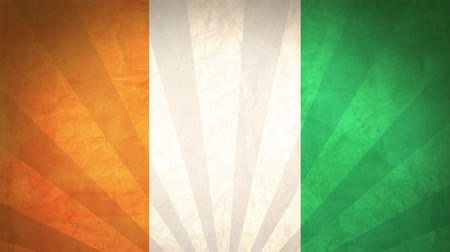Flag Of Ivory Coast. Paper Texture, With Seamlessly Spinning Printed Like Sunrays. High-Quality, Detailed Animation. 4K, 60fps Vidéos Libres De Droits