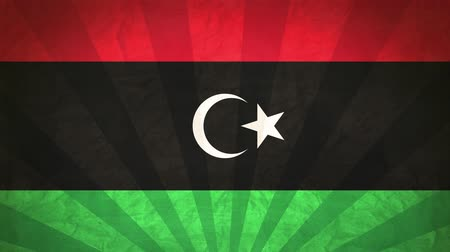 Flag Of Libya. Paper Texture, With Seamlessly Spinning Printed Like Sunrays. High-Quality, Detailed Animation. 4K, 60fps