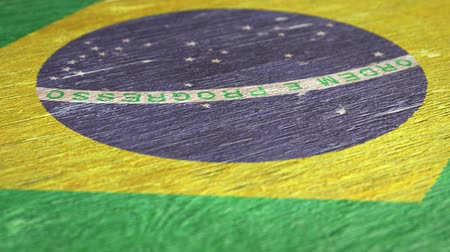 národnost : Flag Of Brazil. Close-Up On Wood, Shallow Depth Of Field, Seamless Loop. High-Quality Animation. Ideal for Your Country  Travel  Political Related Projects. 1080p, 60fps.