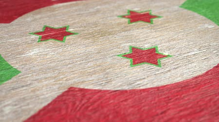 nationality : Flag Of Burundi. Close-Up On Wood, Shallow Depth Of Field, Seamless Loop. High-Quality Animation. Ideal for Your Country  Travel  Political Related Projects. 1080p, 60fps.