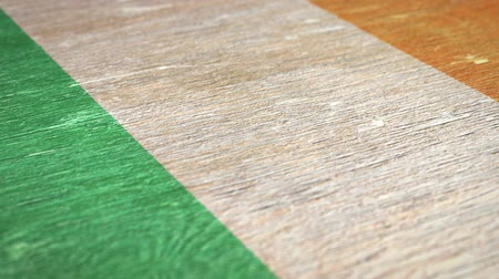 marfim : Flag Of Cote dIvoire. Close-Up On Wood, Shallow Depth Of Field, Seamless Loop. High-Quality Animation. Ideal for Your Country  Travel  Political Related Projects. 1080p, 60fps.