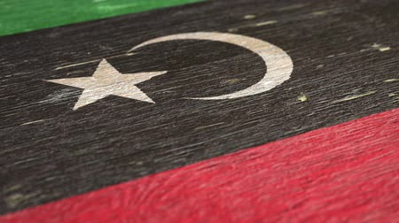 libya : Flag Of Libya. Close-Up On Wood, Shallow Depth Of Field, Seamless Loop. High-Quality Animation. Ideal for Your Country  Travel  Political Related Projects. 1080p, 60fps.