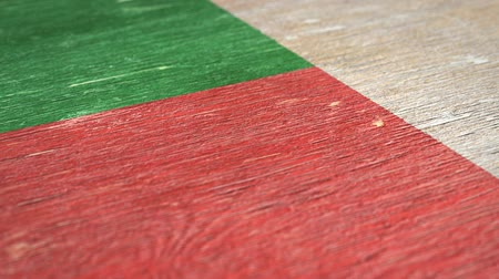 madagaskar : Flag Of Madagascar. Close-Up On Wood, Shallow Depth Of Field, Seamless Loop. High-Quality Animation. Ideal for Your Country  Travel  Political Related Projects. 1080p, 60fps. Dostupné videozáznamy