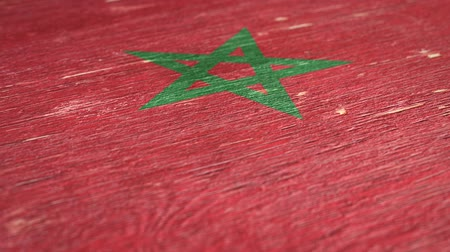 nationalités : Flag of Morocco. Close-Up On Wood, Shallow Depth Of Field, Seamless Loop. High-Quality Animation. Ideal for Your Country  Travel  Political Related Projects. 1080p, 60fps.