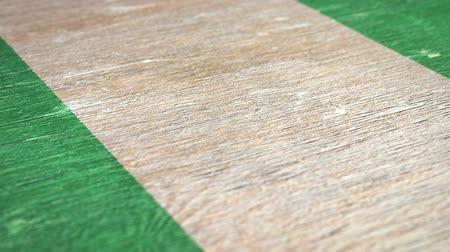 nigeria flag : Flag Of Nigeria. Close-Up On Wood, Shallow Depth Of Field, Seamless Loop. High-Quality Animation. Ideal for Your Country  Travel  Political Related Projects. 1080p, 60fps.