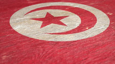 tunus : Flag Of Tunisia. Close-Up On Wood, Shallow Depth Of Field, Seamless Loop. High-Quality Animation. Ideal for Your Country  Travel  Political Related Projects. 1080p, 60fps.