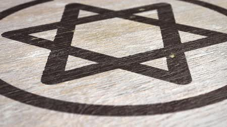 judaizm : Star Of David  Magen - Jewish Symbol On The Wodden Texture. Ideal for Your Judaism  Religion Related Projects. High Quality Seamless Animation. 1080p, 60fps Wideo