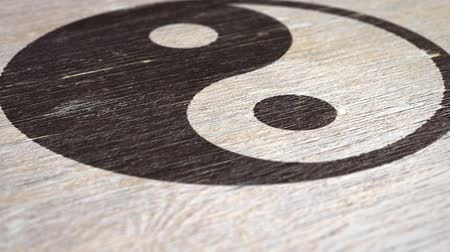 yin and yang : Yin Yang  Tai Chi Symbol On Wodden Texture. Ideal For Your Eastern Philosophy Related Projects. High Quality Seamless Animation. 1080p, 60fps Stock Footage