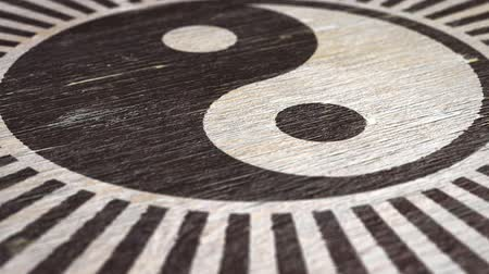 filosofie : Yin Yang  Tai Chi Symbol On Wodden Texture. Ideal For Your Eastern Philosophy Related Projects. High Quality Seamless Animation. 1080p, 60fps Stockvideo