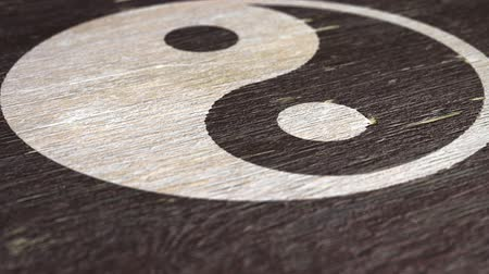 yinyang : Yin Yang  Tai Chi Symbol On Wodden Texture. Ideal For Your Eastern Philosophy Related Projects. High Quality Seamless Animation. 1080p, 60fps Stock Footage