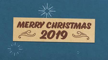 calligraphic : Merry Christmas 2019 Greeting Card On Blue Paper Textured Background. Ideal for Your Christmas Related Project. Seamless High Quality 4K Animation