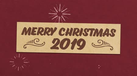Merry Christmas 2019 Greeting Card On Red Paper Textured Background. Ideal for Your Christmas Related Project. Seamless High Quality 4K Animation Vidéos Libres De Droits