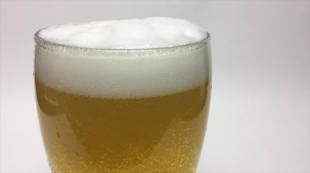 ale : Static shot of beer being poured into a pint glass Stock Footage