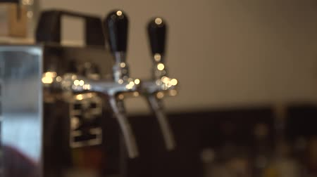A pull focus shot on a beer tap in a pub Стоковые видеозаписи