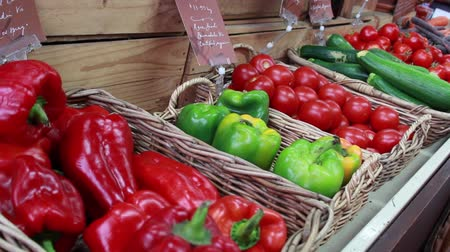 A shot of a basket of red and green peppers at a ood market Стоковые видеозаписи