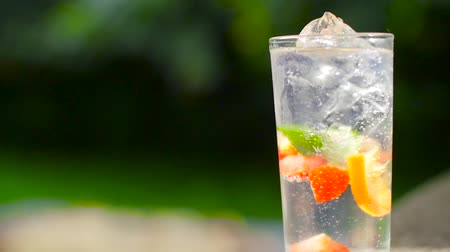 bitter : A shot of a fizzy summer cocktail bubbling in slow motion Stock Footage