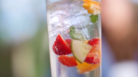 A shot tracking across a fruity summer drink