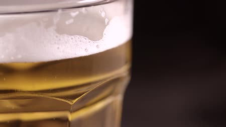 Glass of beer against a black background