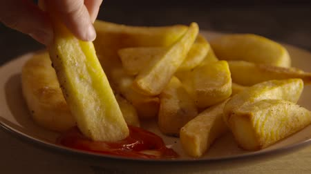 lanches : Short clip of a chip being dunked into ketchup