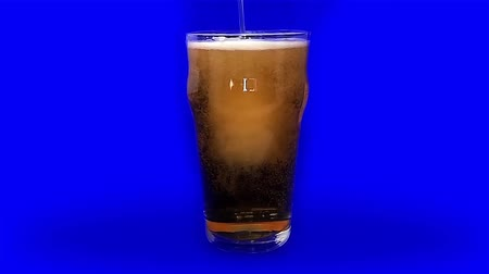 Pouring a pint of beer on a blue chroma screen background