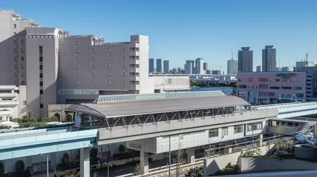 tokyo station : Odaiba, Japan - 11 April 2019 - Odaiba monorail trains stop at a station to send and pick up passengers in Odaiba, Japan on April 11, 2019