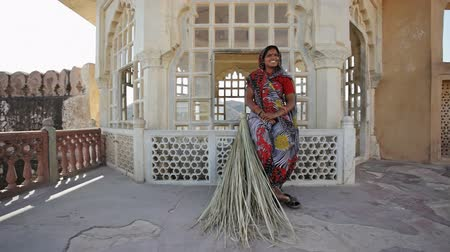 cleaner : Indian Woman in traditional Sari at Amber Fort, Jaipur, Rajasthan, India