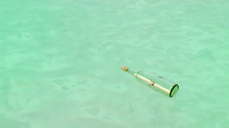 şişeler : Message In A Bottle floating in Caribbean ocean, Cancun, Mexico