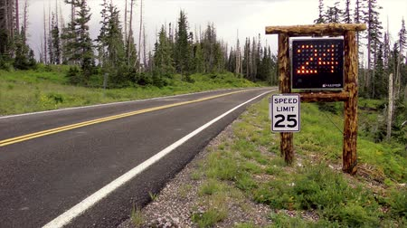 mph : Truck camper driving slowly past an electronic speed limit radar sign
