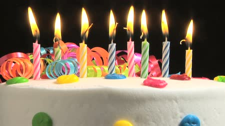 pişmiş : Candles on a Birthday cake burning down, time lapse Stok Video