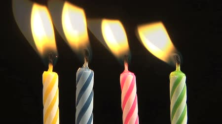 desszertek : Birthday Candles being blown out, slow motion Stock mozgókép