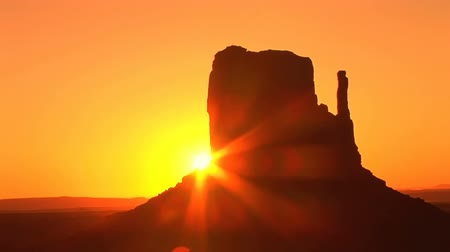 southwest : Sunrise on West Mitten, Monument Valley Navajo Tribal Park, time lapse Stock Footage