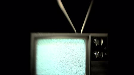 blank : Older television playing static, zoom in Stock Footage