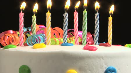 cakes : Candles on a Birthday cake burning down Stock Footage