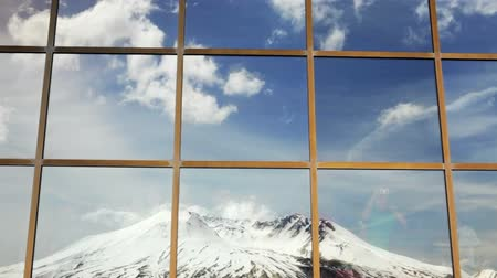 The volcano, Mt. St. Helens, reflection in a window. Tourists viewing mountain from inside Johnston Ridge Observatory.