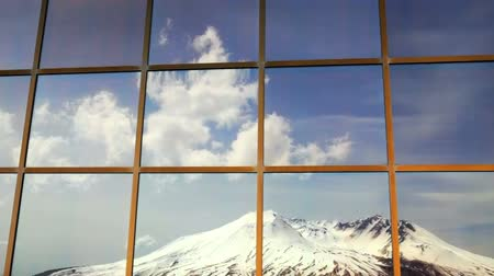 The volcano, Mt. St. Helens, reflection in a window. Time Lapse