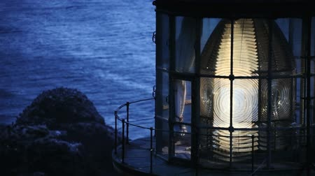 night : Close up of the lens lit up and rotating in Heceta Head Lighthouse, includes high quality audio.