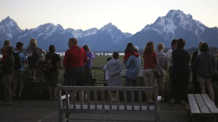 grand tetons : Tourists looking at the Teton range from Jackson Lake Lodge