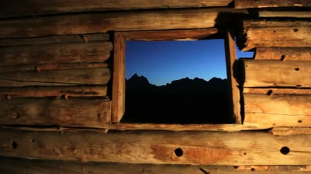 grand tetons : View of the Grand Tetons from inside the Cunningham Cabin at night, dolly shot