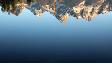 grand tetons : A reflection of the Grand Tetons in the Snake River Stock Footage