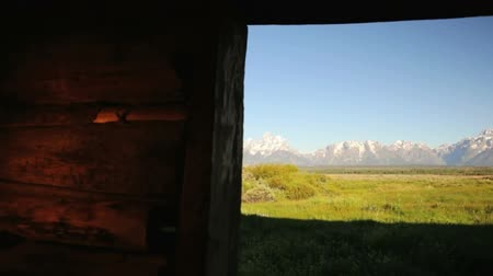 grand tetons : View of the Grand Tetons from inside the Cunningham Cabin, dolly shot