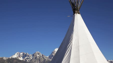 grand tetons : Tip of a teepee in Grand Teton National Park, dolly shot