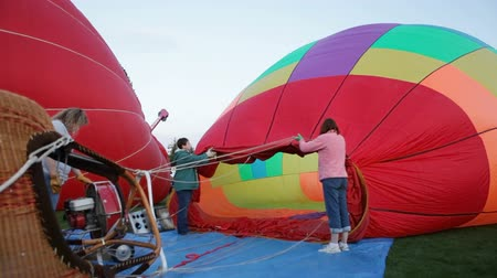 expansion : Using a fan to inflate a hot air balloon at the annual Tigard Festival of Balloons