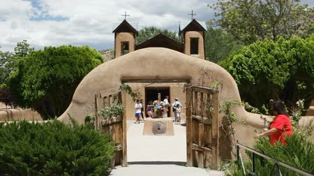 Open wooden doors leading to El Santuario de Chimayo in Chimayo, New Mexico