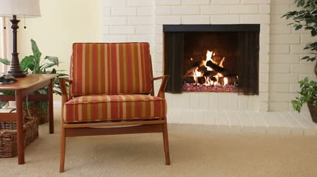 Chair next to fireplace in residential home Wideo