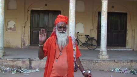 ascetic : Sadhu or Holy Man wearing brightly colored robes, Jaipur, Rajasthan, India