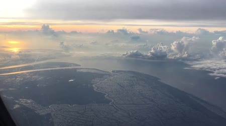 ninh : Scenic from from window plane overlooking Vietnam seashore at sunrise Stock Footage
