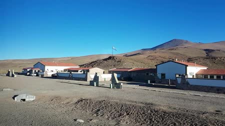 crossing road : Scene from Border Crossing Argentina South America Slow Still Motion close up Early Morning flag flying outpost buildings