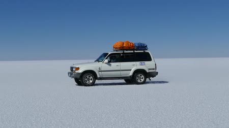 drive through : Scene from Boliva South America Slow Motion of truck jeep journey through the salt flats