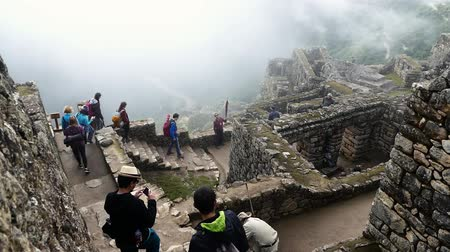 перуанский : Scene from Mach Picchu Peru South America Slow Motion view of the buildings and landscape